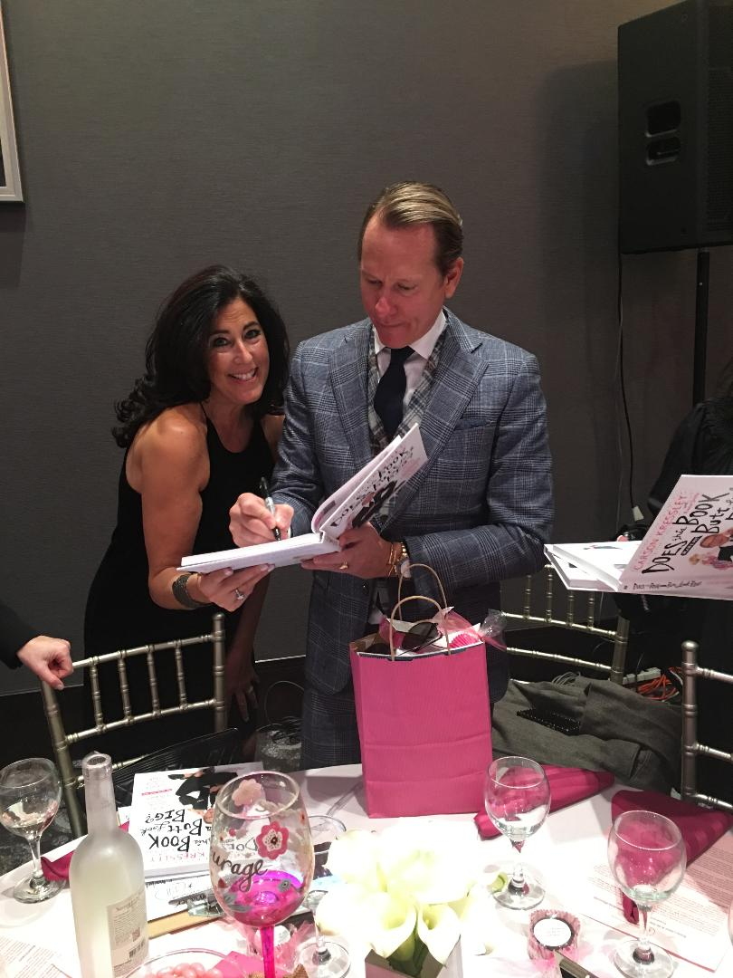 Carson signing my book